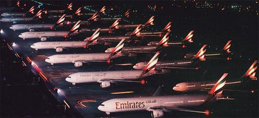 Image: Emirates planes at evening.