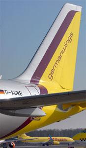 Image: Germanwings tailfin & TUIfly plane on runway