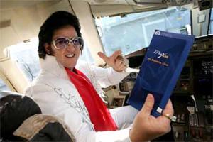 Image: Elvis on board a MaxJet flight