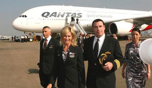 Image: John Travolta and Olivia Newton John disembarking Qantas flight