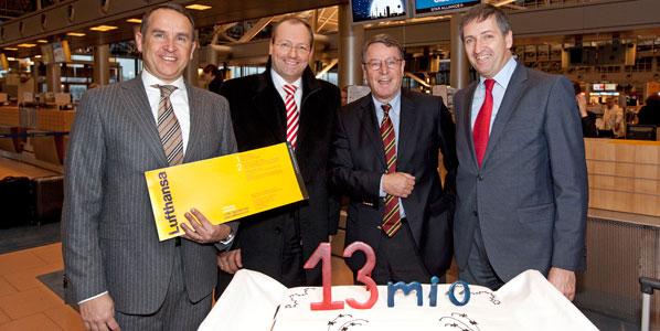Hamburg Airport celebrates its 13-millionth passenger with a cake.