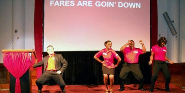 REDjet staff dance to celebrate REDjet's fare prices going down.