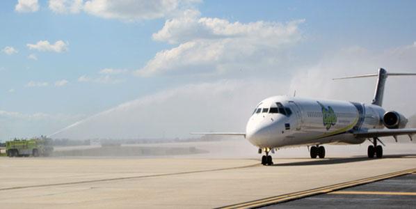 Seen receiving the fire-truck water arch treatment is a Dutch Antilles Express MD-83 at Orlando International Airport, FL.