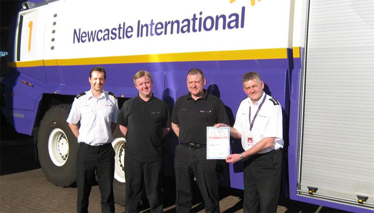 Steve Armstrong, Dave Smith, Steve Cockburn and Steve Murray show off their 'Arch of Triumph' award.