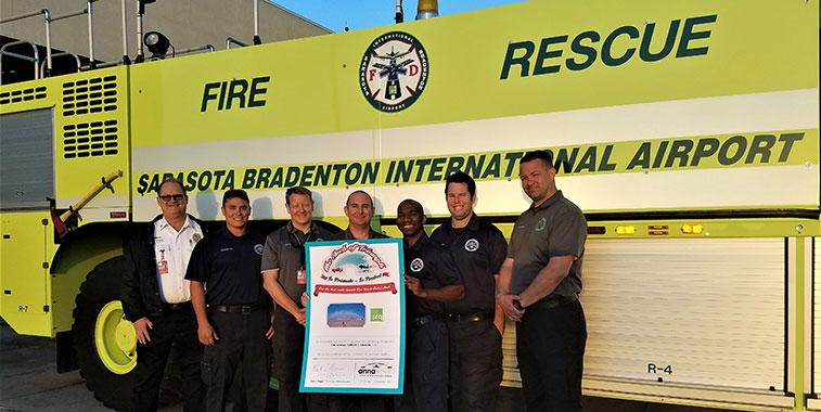 Pictured with their super-sized certificate are Sarasota Airport's: Chief Bill Quinn, FF. Nick Esposito, Capt. Jason Barnard, Capt. Mark Hoffman, Senior FF, Dino Bogie, FF Ben Sharpe, Capt. Matthew Gray.