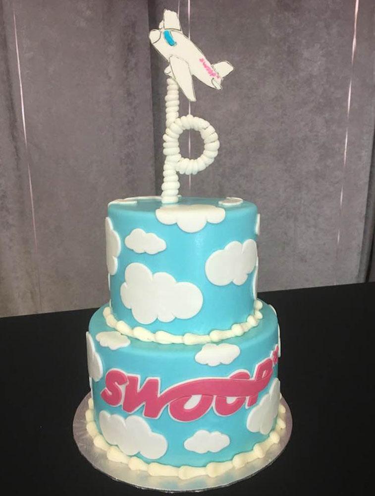 Swoop Edmonton cake celebration